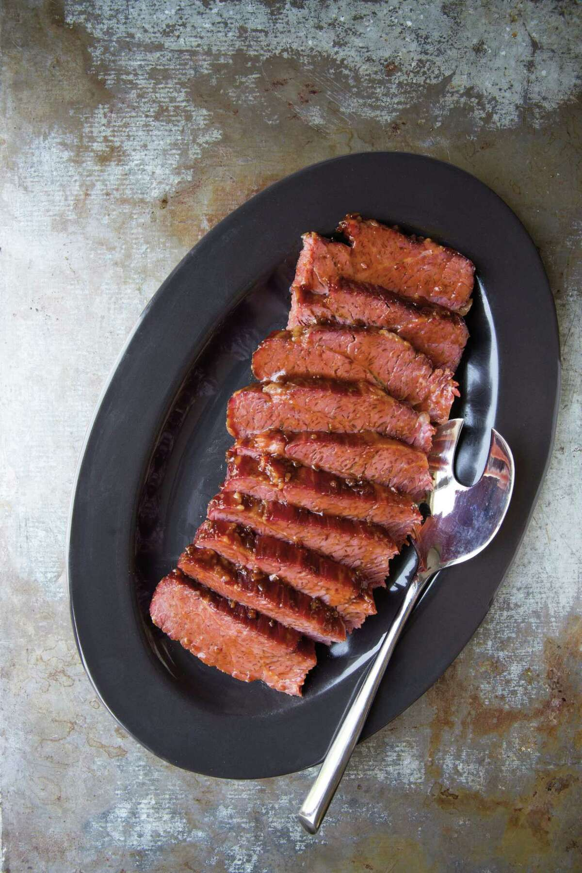 """Asian glazed corned beef features a 3 to 4 pound pickled brisket that is glazed with a combination teriyaki, sugar and honey glaze. The recipe is featured in author Miriam Pascal's book """"Real Life Kosher Cooking."""""""