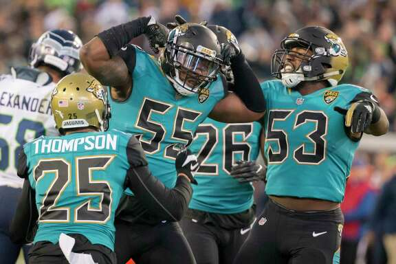 Jacksonville Jaguars defensive end Lerentee McCray (55) celebrates a tackle against the Seattle Seahawks during the first half of an NFL football game, Sunday, Dec. 10, 2017, in Jacksonville, Fla. (AP Photo/Stephen B. Morton)