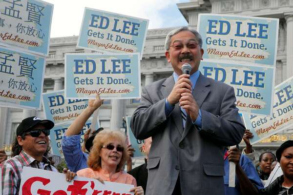 San Francisco mayor Ed Lee speaks to a large group outside City Hall prior to casting his early vote in the municipal election Tuesday October 11, 2011.