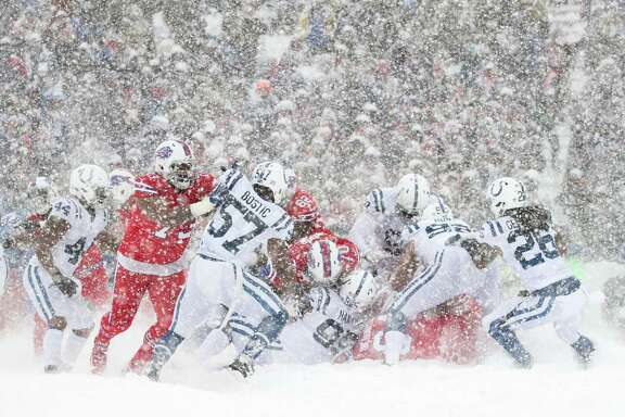 ORCHARD PARK, NY - DECEMBER 10:  The Buffalo Bills and Indianapolis Colts during the second quarter of a snowy game on December 10, 2017 at New Era Field in Orchard Park, New York.