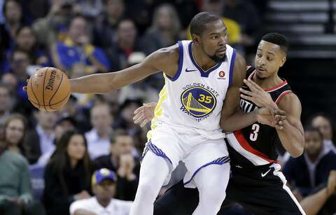 4f8ae8658cec Golden State Warriors  Kevin Durant (35) is defended by Portland Trail  Blazers