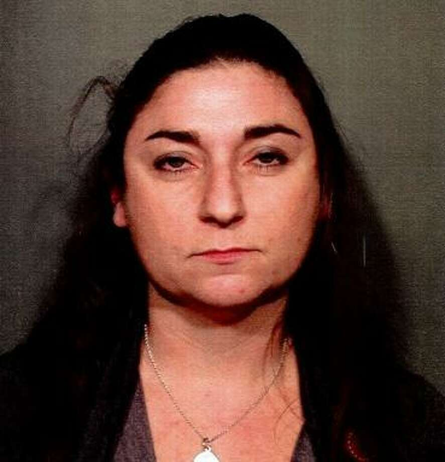 Emily Hogan, 37, of Norwalk was charged with reckless driving and drinking while driving after she crashed her car with alcohol in the vehicle in New Canaan, Conn. on Nov. 21, 2017. Photo: Contributed Photo / Contributed Photo / New Canaan News contributed