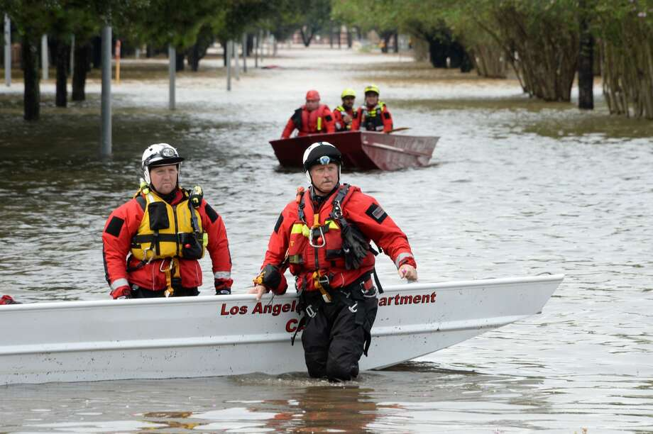 Emergency crews from across the Nation respond to flooding on the west side of the Barker Reservoir along South Mason Road in the Cinco Ranch and Canyon Gate subdivisions of Ft. Bend County, TX on August 29, 2017. Photo: Craig Moseley/Houston Chronicle