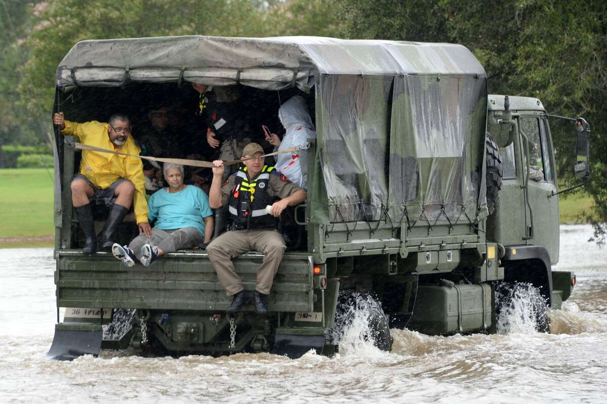 Residents of the Cinco Ranch and Kelliwood areas of Ft. Bend and Harris Counties evacuate from the west side of the Barker Reservoir along Westheimer Parkway in Katy, Texas, on Aug. 29, 2017.