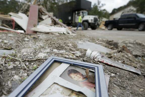 A photograph lays in the debris in Bear Creek, a neighborhood in the Addicks reservoir flood pool.