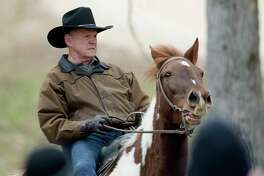 Republican senate nominee Roy Moore rides a horse to a polling station to cast his ballot in Alabama's special Senate election, Tuesday, Dec. 12, 2017, in Gallant, Ala. (Albert Cesare/The Montgomery Advertiser via AP)