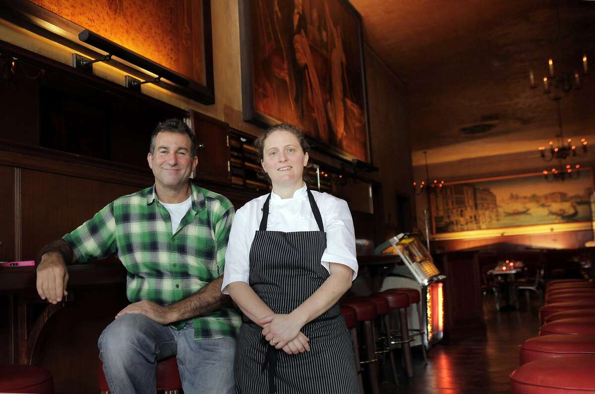 Ken Friedman, left, and April Bloomfield hope to reinvigorate business at Tosca with a new kitchen at the historic establishment. San Francisco's legendary Tosca is set to reopen this week under new ownership, featuring a restaurant as well as the bar. April Bloomfield of Spotted Pig helms the dining, and Co-owner Ken Friedman hopes the changes will bring back regulars and a new crowd. The San Francisco, Calif., mainstay is seen here on Monday, October 7, 2013.