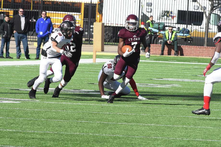 Cy Fair running back Trenton Kennedym above, and the defense led the Bobcats to its first regional championship since 1985.  Caption CyFair No. 7 WR Eddie Sumler runs  a reverse for a first down, in the playoff game Saturday 12/9'2017 against Langham Creek.at the Berry Center. Photo: Tony Gaines/ HCN, Photographer