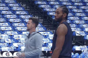 The Spurs' Kawhi Leonard participates in the team shootaround Tuesday, Dec. 12, 2017, in Dallas as the Silver & Black get ready to face the Mavericks. Coach Gregg Popovich confirmed that Leonard would play Tuesday. It will be his first game action since May 14, 2017, when the Spurs fell 113-111 in Game 1 of the Western Conference Finals.
