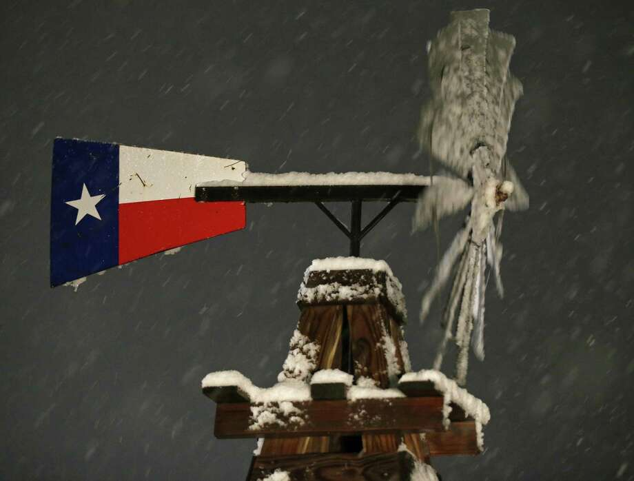 A windmill with snow Thursday Dec. 7, 2017 in Leon Springs. Photo: Edward A. Ornelas, Staff / San Antonio Express-News / © 2017 San Antonio Express-News