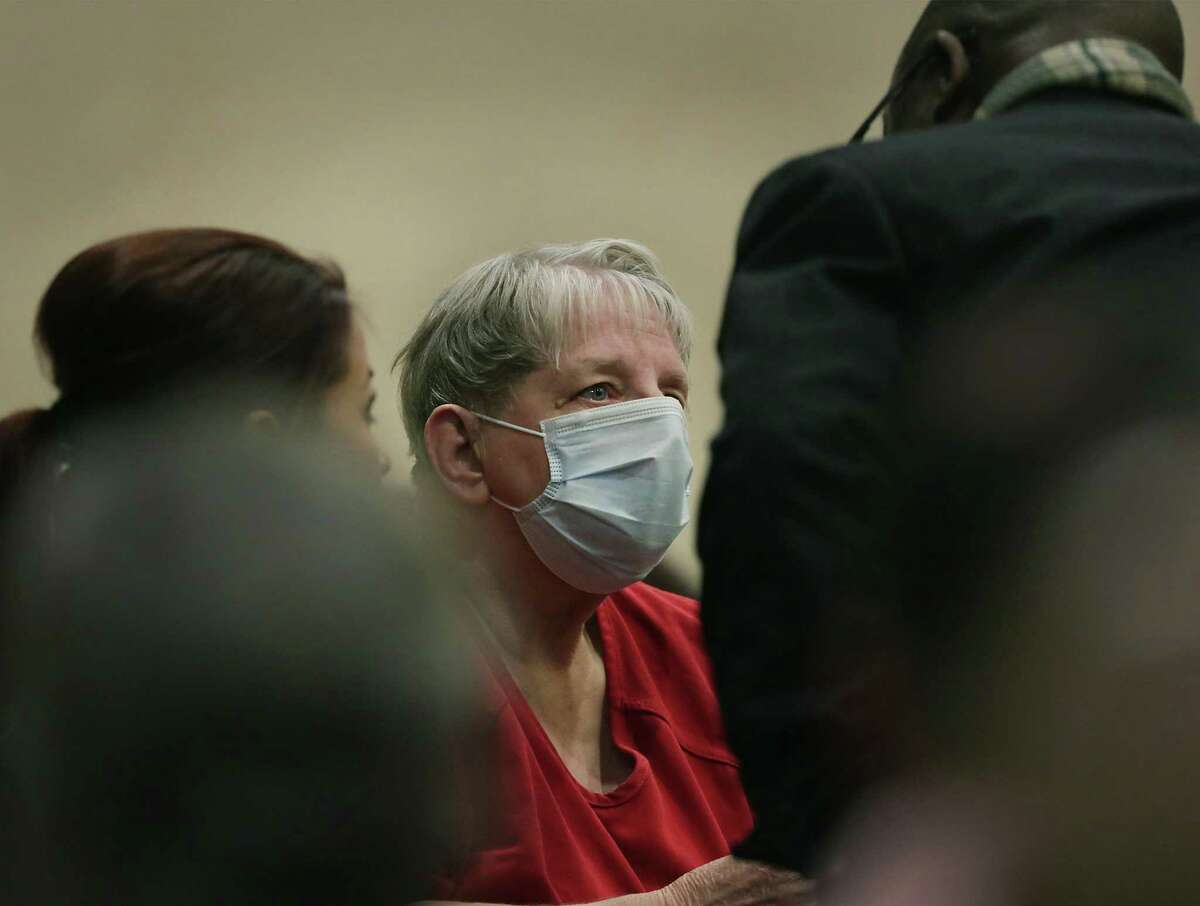Convicted child killer Genene Jones, center, listens to her lawyer Cornelius Cox, right, after arriving at the Cadena-Reeves Justice Center to be arraigned in the 399th State District Court, on Thursday, Dec. 7, 2017.
