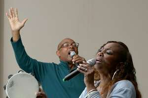 Associate pastor Robert Smith (left) and Rosita Watson (front) sing during choir practice at Global Christian Ministries on Tuesday, November 28, 2017, in El Sobrante, Calif.