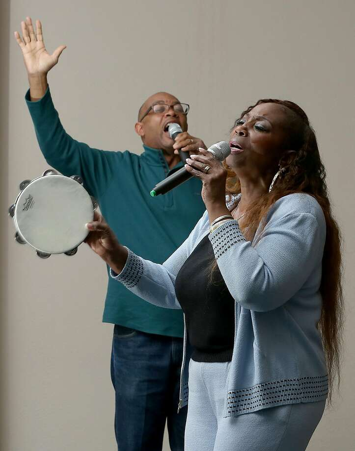 Associate Pastor Robert Smith (left) and Rosita Watson sing during choir practice at Global Christian Ministries in El Sobrante, which is just five minutes from her new home. Photo: Liz Hafalia, The Chronicle