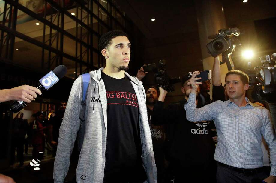 "FILE - In this Nov. 14, 2017, file photo, UCLA basketball player LiAngelo Ball is surrounded by reporters and photographers as he leaves Los Angeles International Airport in Los Angeles. A basketball club from Lithuania says it has signed LiAngelo and LaMelo Ball to pro contracts, making them ineligible for college basketball. The Prienai-Birstonas Vytautas club, which plays in the Lithuanian league, says the brothers will report to the club ""in early January,"" in a website statement.   (AP Photo/Jae C. Hong, File) Photo: Jae C. Hong, Associated Press / Copyright 2017 The Associated Press. All rights reserved."
