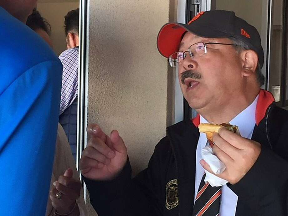Mayor Ed Lee eats a hot dog on the Giants' opening day in 2017 Photo: Leah Garchik, San Francisco Chronicle