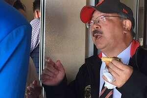 Mayor Ed Lee eats a hot dog on opening day, 2017
