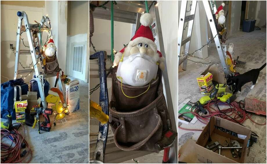 A couple in northwest Houston has made the most of their ongoing rebuilding efforts following flood damage from Hurricane Harvey by decorating one of their ladders like a Christmas tree. Photo: Walt Stone