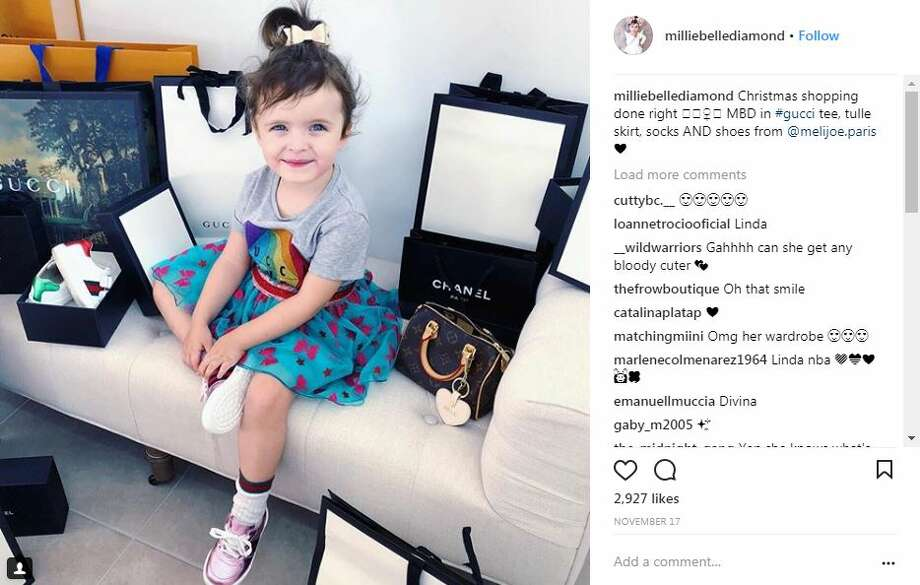 Designer toddler Millie-Belle Diamond's Instagram account, managed by mum Schye Fox, has nearly 160,000 followers. She apparently gets sent free designer gear by brands and is paid up to AUD $250 (£140, $190) a post to share photos of her wearing it. Photo: Milliebellediamond Via Instagram
