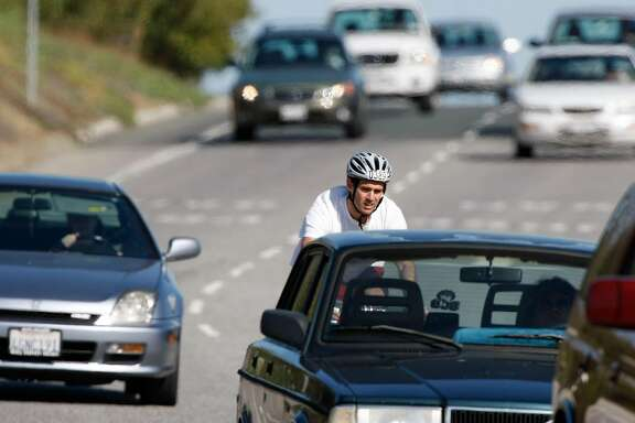 Bicyclists on westbound Sand Hill Road near Interstate 280 in Menlo Park, Calif., need to cross one lane of traffic (that leads to a freeway onramp) to continue in the bike lane over I-280. Photo taken on March 20, 2008. Photo by Michael Maloney / San Francisco Chronicle