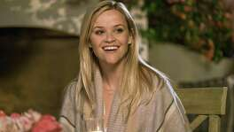 "Reese Witherspoon is more comfortable being a den mother than a cougar in ""Home Again."""