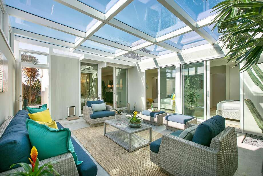 Sliding glass doors off the home open to the sunny atrium. Photo: Open Homes Photography