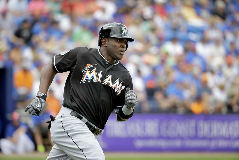 Miami Marlins' Marcell Ozuna heads to first with a single during the first inning of an exhibition spring training baseball game against the New York Mets Friday, March 4, 2016, in Port St. Lucie, Fla. (AP Photo/Jeff Roberson) Photo: Jeff Roberson, AP