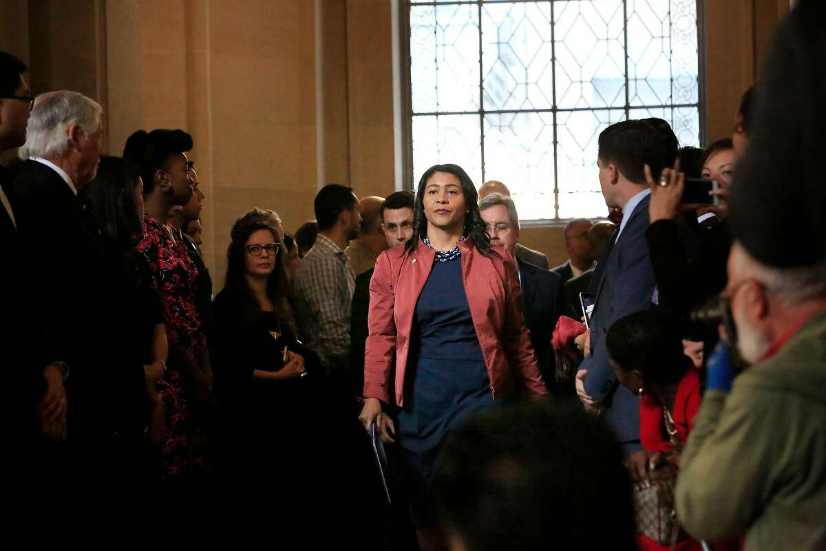 Acting Mayor London Breed arrives with others to a press conference outside the Mayor's Office at City Hall on Tuesday, December 12, 2017 in San Francisco, Calif.