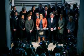 Acting Mayor London Breed is surrounded by city officials during a City Hall news conference following the announcement that Mayor Ed Lee has died in San Francisco, Calif. on Tuesday, Dec. 12, 2017.