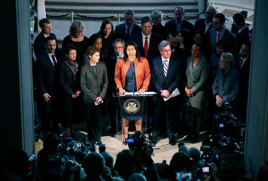 Acting Mayor London Breed is surrounded by officials during a City Hall news conference following the announcement that Mayor Ed Lee has died. Photo: Paul Chinn, The Chronicle