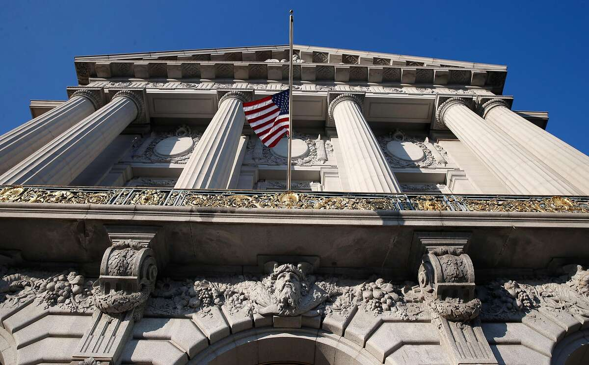 A flag is lowered to half mast from the mayor�s office balcony at City Hall following the announcement that Mayor Ed Lee has died in San Francisco, Calif. on Tuesday, Dec. 12, 2017.