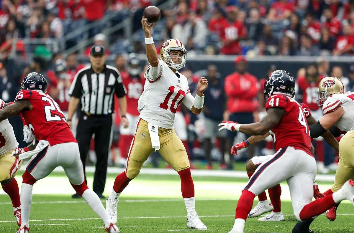 San Francisco 49ers quarterback Jimmy Garoppolo (10) throws a pass over Houston Texans inside linebacker Zach Cunningham (41) during the fourth quarter of an NFL football game at NRG Stadium on Sunday, Dec. 10, 2017, in Houston. ( Brett Coomer / Houston Chronicle )