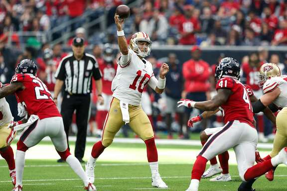 San Francisco 49ers quarterback Jimmy Garoppolo (10) throws a pass over Houston Texans inside linebacker Zach Cunningham (41) during the fourth quarter of an NFL football game at NRG Stadium on Sunday, Dec. 10, 2017, in Houston. ( Brett Coomer / Houston Chronicle )
