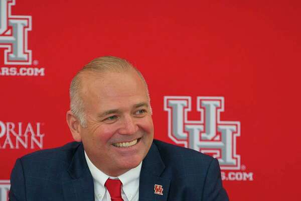 New University of Houston athletic director Chris Pezman listens to questions during an introductory press conference with board chairman Tilman Fertitta and university chancellor Renu Khator at TDECU Stadium, Tuesday, Dec. 12, 2017, in Houston.
