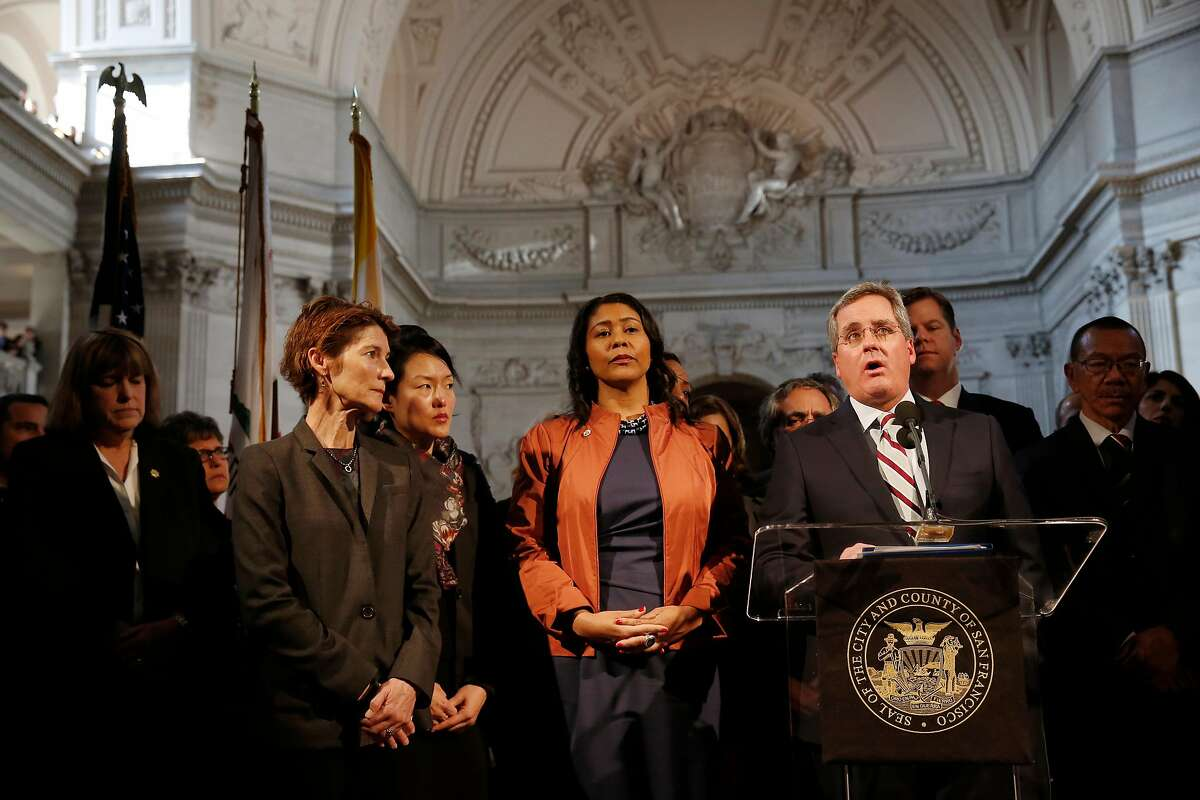 City Attorney Dennis Herrera (right) speaks during a press conference as he stands with Acting Mayor London Breed (center) at City Hall on Tuesday, December 12, 2017 in San Francisco, Calif. In a statement this morning, officials from the mayor's office said that Lee passed away at 1:11 a.m. at the Zuckerberg San Francisco General Hospital. Lee was 65 years old.