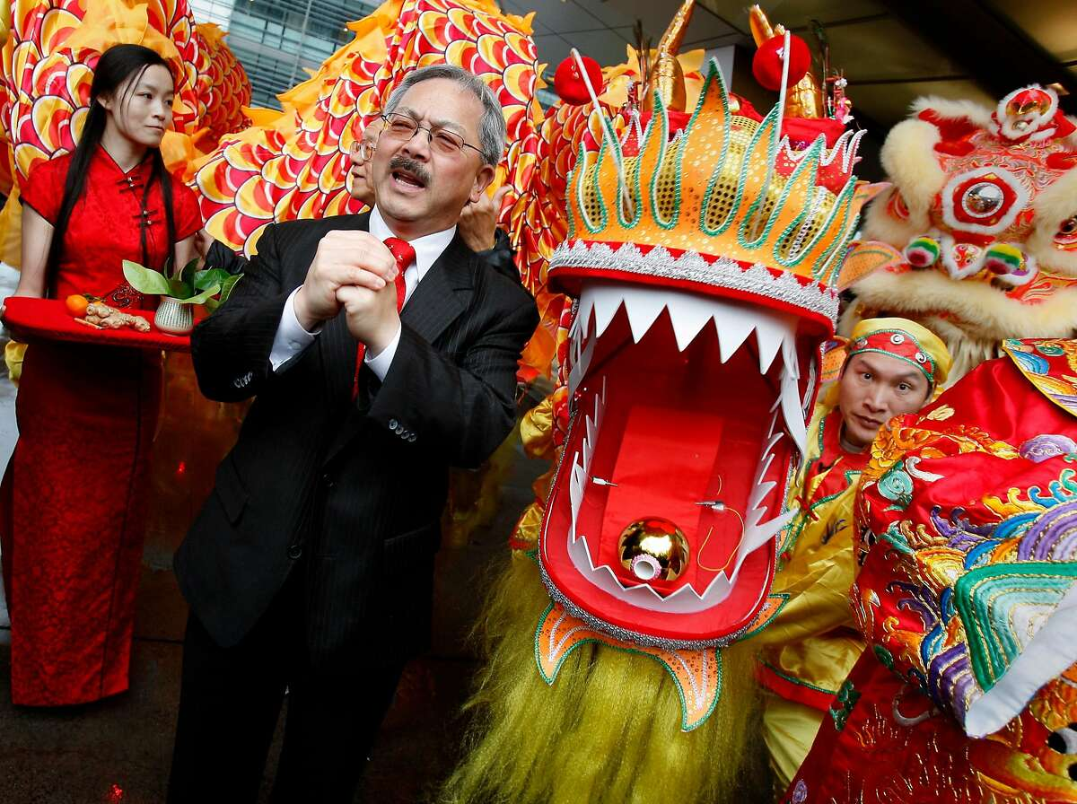 FILE-- Mayor Ed Lee helped decorate the new dragon (right) being unveiled and gave a speech. Hundreds turned out to celebrate the first day of the Chinese New Year in Chinatown Monday January 23, 2012 including San Francisco Mayor Ed Lee.