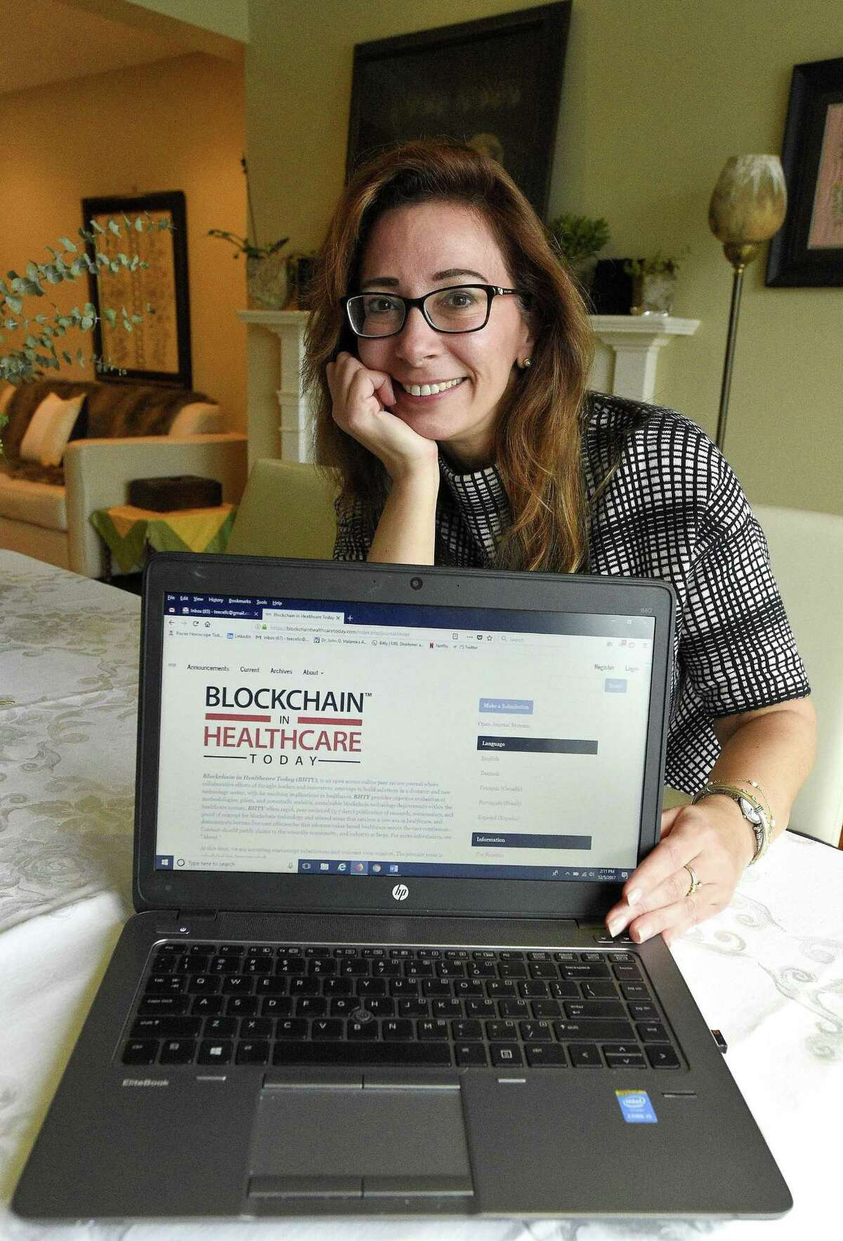 Tory Cenaj, founder and publisher of the new online journal Blockchain in Healthcare Today, is photographed, on Dec. 5, 2017, at her home in Stamford, Conn.