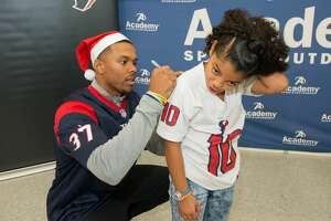 Houston Texans rookie class take local area youth on a Christmas shopping spree at Academy Sports + Outdoors. Each child was also given a bike and helmet.