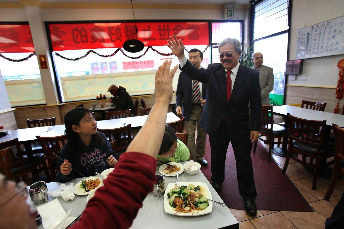 Diners greet Mayor Ed Lee as he arrives at King Wonton & Noodle during a Sunset District Merchant Walk on Monday, August 8, 2011 in San Francisco, Calif.