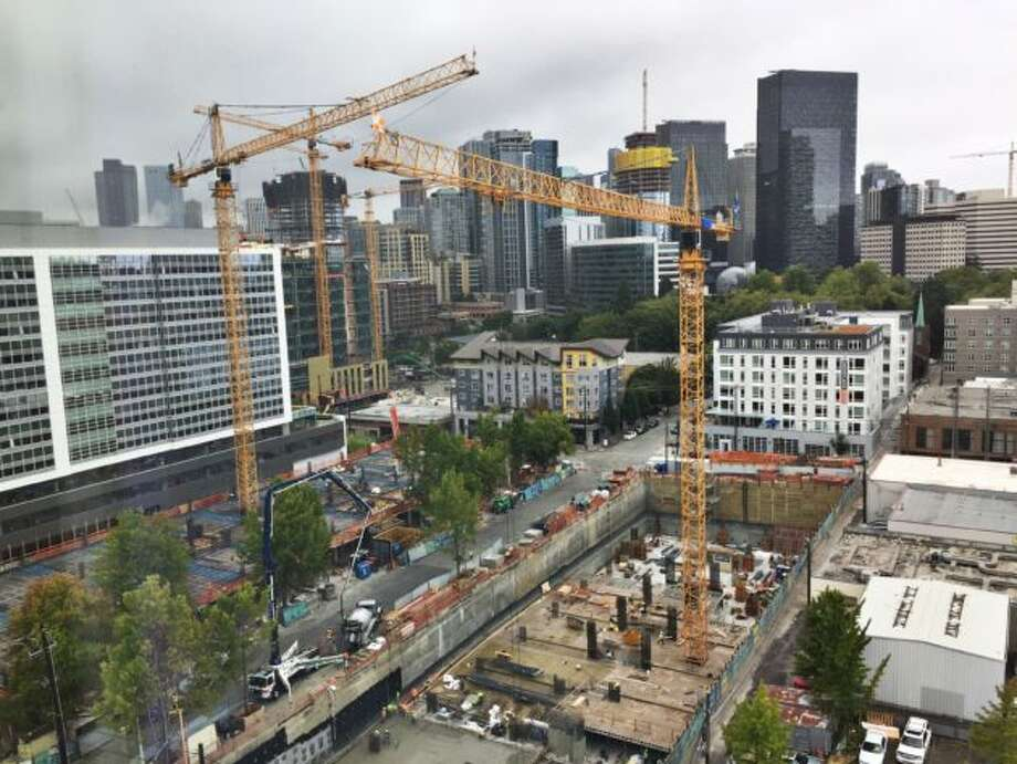 Cranes dot the neighborhood around Amazon's South lake Union campus, with its Doppler and Day 1 towers and Spheres visible at top right. Photo: Kurt Schlosser/GeekWire