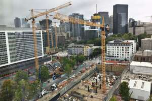 Cranes dot the neighborhood around Amazon's South lake Union campus, with its Doppler and Day 1 towers and Spheres visible at top right.