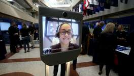 Shawnta Swindell appears on screen from New York City on a virtual telepresence robot — also known as a Beam model robot — Tuesday at USAA's innovation day. The event shows off some of the latest concepts USAA is working on or has recently launched.