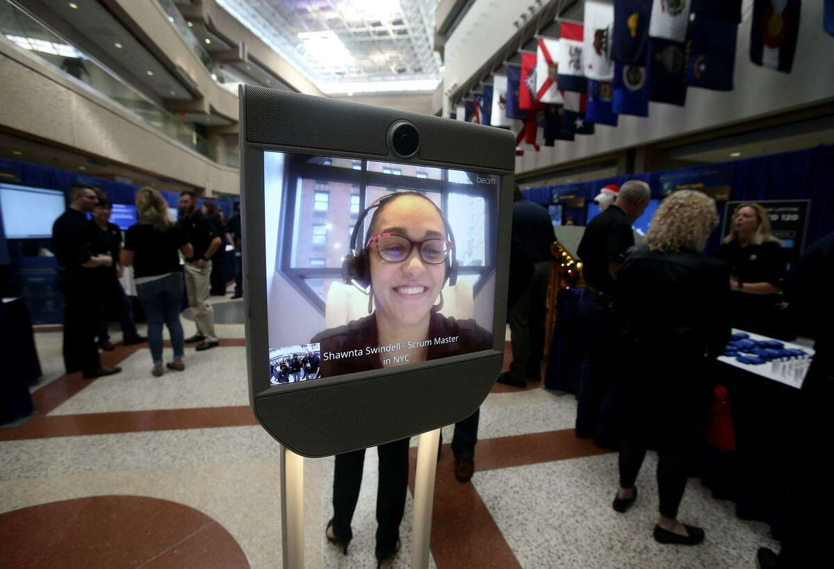 Shawnta Swindell appears on screen from New York City on a virtual telepresence robot - also known as a Beam model robot - Tuesday at USAA's Innovation Day. The event shows off some of the latest concepts USAA is working on or has recently launched.