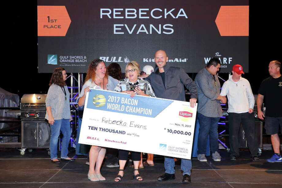 Rebecka Evans from Houston picks up her $10,000 at the 2017 World Bacon Champion title. Evans won for her Dutch Crunch Baby Pancakes at the World Food Championships, which was held Nov. 8-12 at The Wharf in Orange Beach, Ala. Photo: Courtesy Photo / Copyright 2015 All Rights Reserved