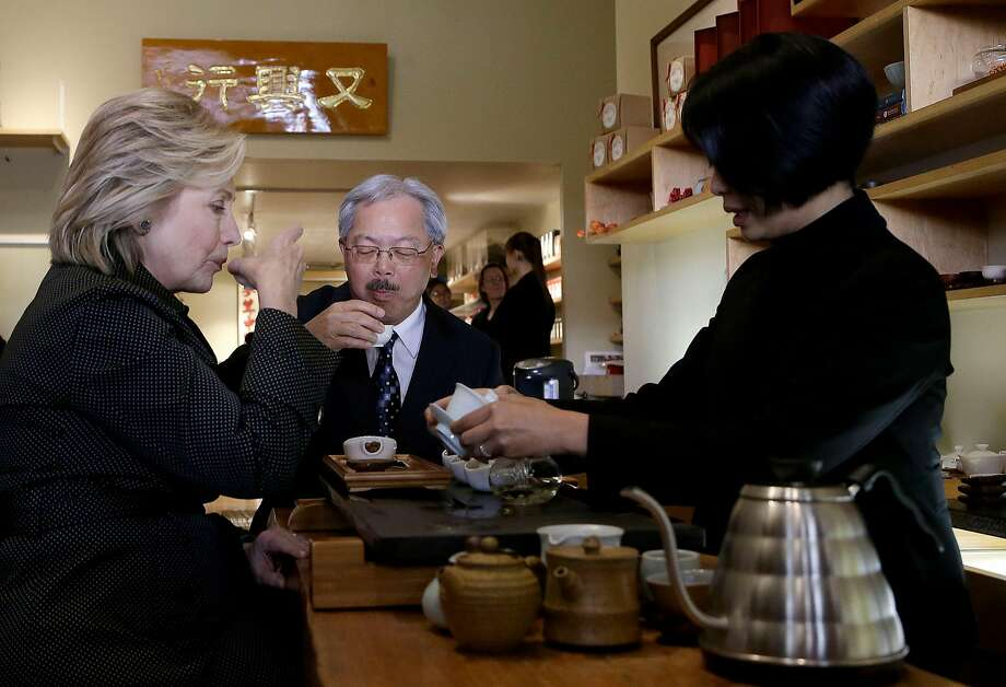 Democratic presidential candidate Hillary Rodham Clinton, left, and San Francisco Mayor Ed Lee, center, sample tea from Alice Luong at Red Blossom Tea Company in Chinatown in San Francisco, Wednesday, May 6, 2015. Photo: Jeff Chiu, Associated Press