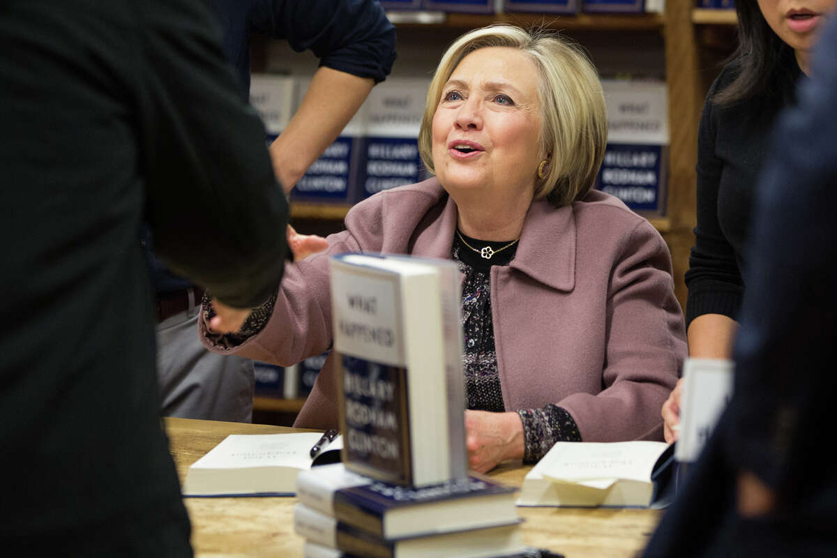 Hillary Clinton greets supporters during a book signing at Elliott Bay Book Company in Capitol Hill on Tuesday, Dec. 12, 2017. Clinton is currently on a speaking tour and promoting her new book,