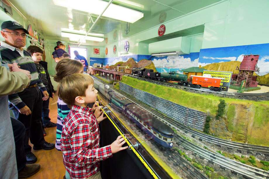 Daniel Viator, 5, was really excited about visiting the Tomball model train display. Residents and train buffs were able to tour the new Tomball & Walden Model Railway recently during the annual Tomball German Christmas Market. The T&W Model Railway is located inside the old caboose just south of the depot building at 201 South Elm Street. Photo: Tony Gaines/ HCN, Photographer