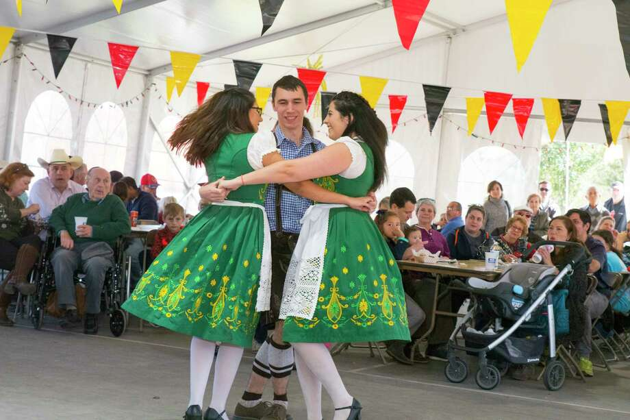 Melissa Guitar, Zach Brown and Lexi Kokines, dancers of the (Das Its Keine Kunst ) folk dance group at  the German festival, at the Tomball Depot. Photo: Tony Gaines/ HCN, Photographer