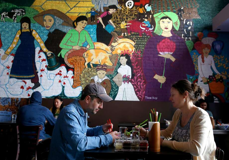 Ben and Nikki Luna have lunch at the Temple Club in Oakland. Photo: Paul Chinn, The Chronicle