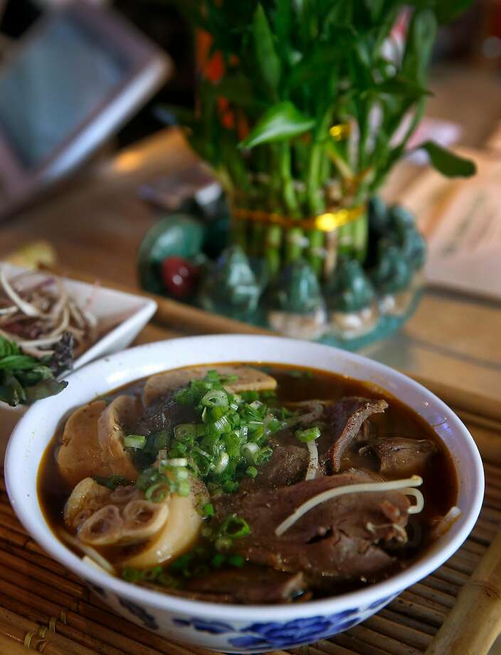 A bowl of bun bo hue noodles in beef broth at the Temple Club. Photo: Paul Chinn, The Chronicle