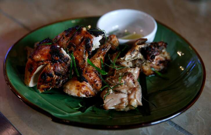 An order of the Ga Nuong La Chanh grilled chicken is ready to serve at The Temple Club Vietnamese restaurant in Oakland, Calif. on Saturday, Nov. 25, 2017.